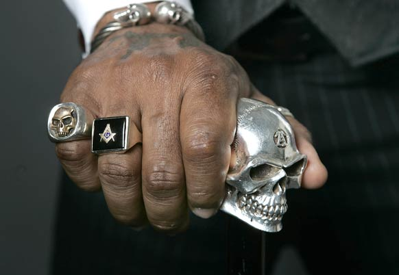 In addition to his Masonic ring and several tattoos with Masonic motifs,