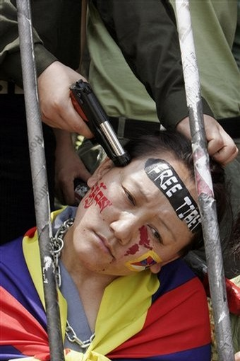 2008 file photo, a Tibetan woman in exile enacts a scene of oppression ...