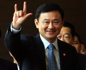 Thaksin Shinawatra gives the secret sign