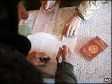 Woman uses her old Soviet internal passport as ID to vote in Kochiyer, Moldova, April 5