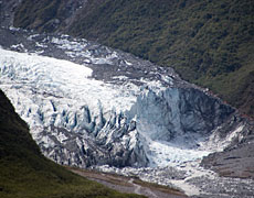 New Zealand weather patterns mean the Fox Glacier is still growing despite global warming.