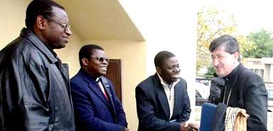 Uwayezu, far left, meets Giuseppe Betori, archbishop of Florence,