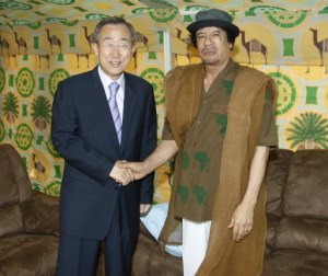 Libyan dictator shakes hands with UN Secy Gen Ban Ki Moon at the NAM conference