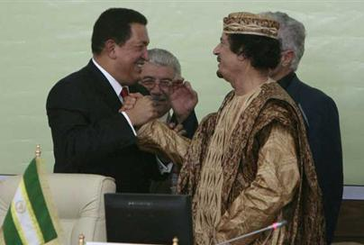 Muammar Gaddafi  shakes hands with Hugo Chavez during the summit on regional conflicts in Tripoli August 31, 2009. REUTERS Zohra Bensemra