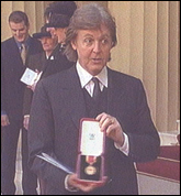 Paul McCartney is knighted individually by Queen Elizabeth in 1997